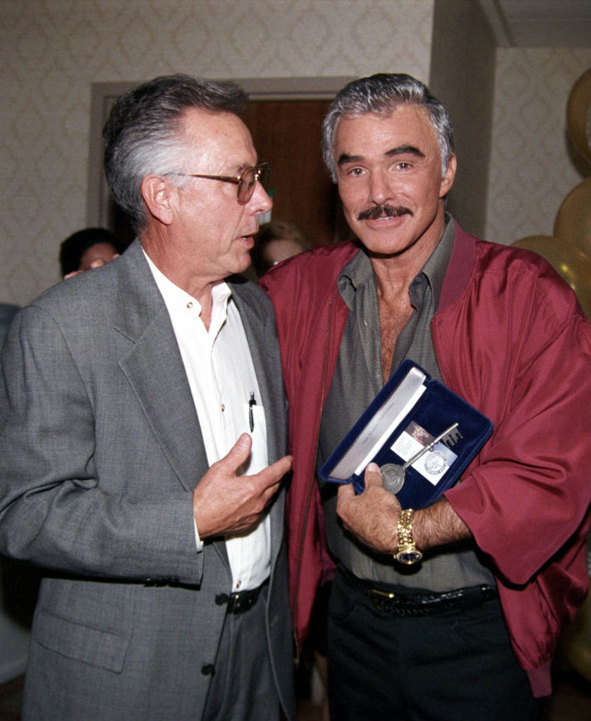 Burt Reynolds receives a key to the city from Las Vegas City Councilman Gary Reese July 11, 2002 at the Orleans. (Las Vegas News Bureau)