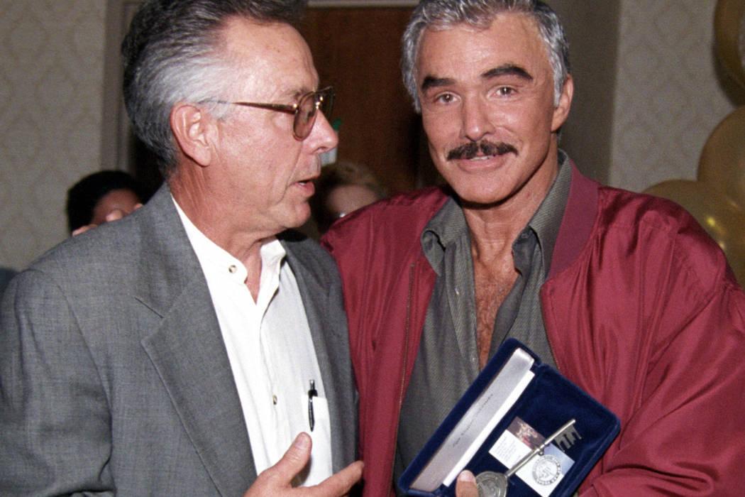 Burt Reynolds receives a key to the city from Las Vegas City Councilman Gary Reese July 11, 2002 at The Orleans. (Bob Brye/Las Vegas News Bureau)