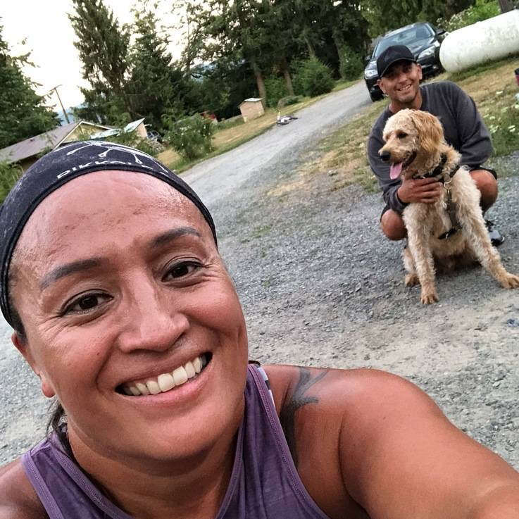 Joseph Johnson and his wife Lona, left, both of Whatcom County in Washington state, pose for a photo with their dog, Jax. (Lona Johnson via AP)
