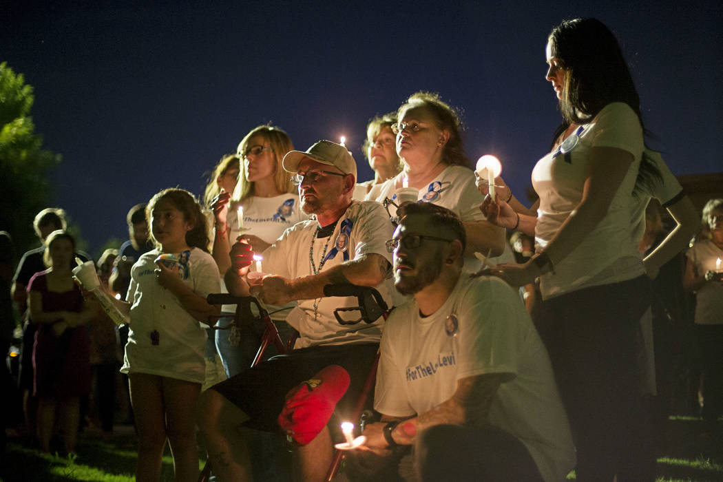 Jose Echenique, center, father of 8-year-old Levi Echenique listens next to his family at a vigil at Paradise Park in Las Vegas, Sunday, Sept. 9, 2018. Levi was killed in a car crash on Aug. 31. H ...