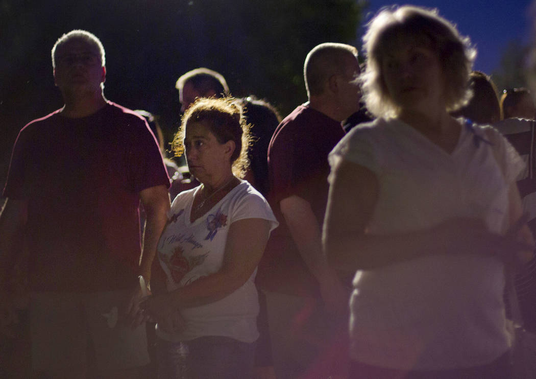 Margina Mujica cries as she speaks to Jose Echenique, father of 8-year-old Levi Echenique, at a vigil at Paradise Park in Las Vegas, Sunday, Sept. 9, 2018. Levi was killed in a car crash on Aug. 3 ...