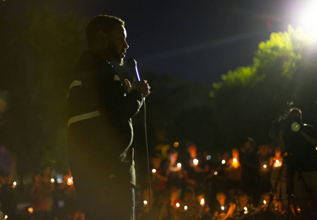 Cameron H. Miller delivers a speech to friends and family of 8-year-old Levi Echenique at a vigil at Paradise Park in Las Vegas, Sunday, Sept. 9, 2018. Echenique was killed in a car crash on Aug. ...