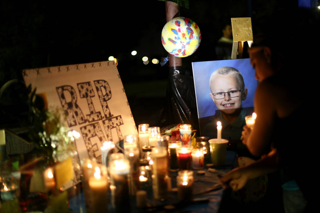 Candles and a photo of 8-year-old Levi Echenique at a vigil at Paradise Park in Las Vegas, Sunday, Sept. 9, 2018. Echenique was killed in a car crash on Aug. 31. His parents Breijet and Jose Echen ...