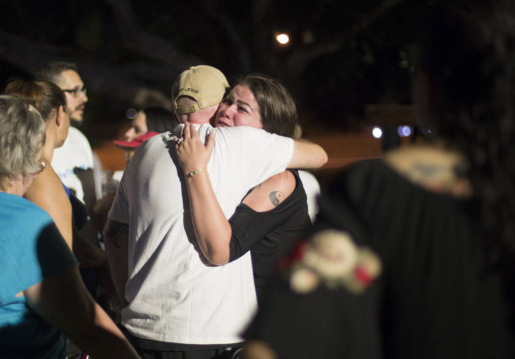 Margina Mujica cries as hugs Jose Echenique, father of 8-year-old Levi Echenique, at a vigil at Paradise Park in Las Vegas, Sunday, Sept. 9, 2018. Levi was killed in a car crash on Aug. 31. His pa ...