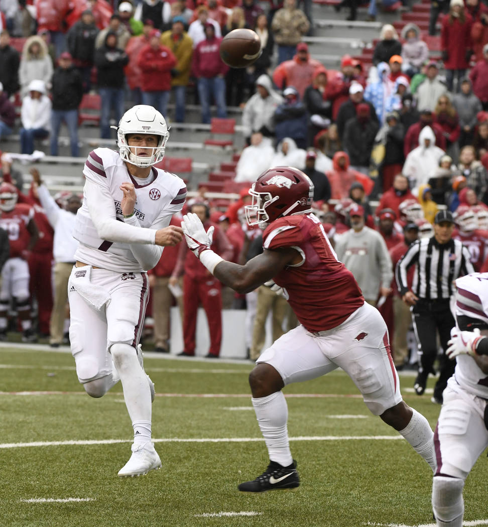 Mississippi State quarterback Nick Fitzgerald throws the go ahead touchdown pass against Arkansas during the second half of an NCAA college football game Saturday, Nov. 18, 2017 in Fayetteville, A ...