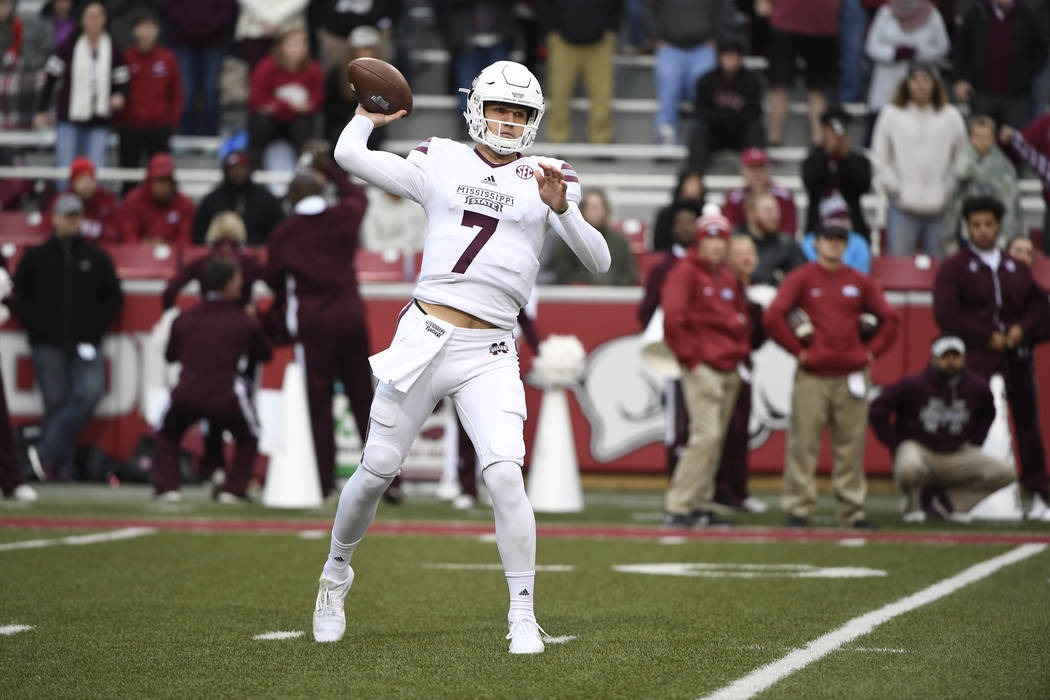 Mississippi State quarterback Nick Fitzgerald drops back to pass against Arkansas during the first half of an NCAA college football game Saturday, Nov. 18, 2017 in Fayetteville, Ark. (AP Photo/Mic ...