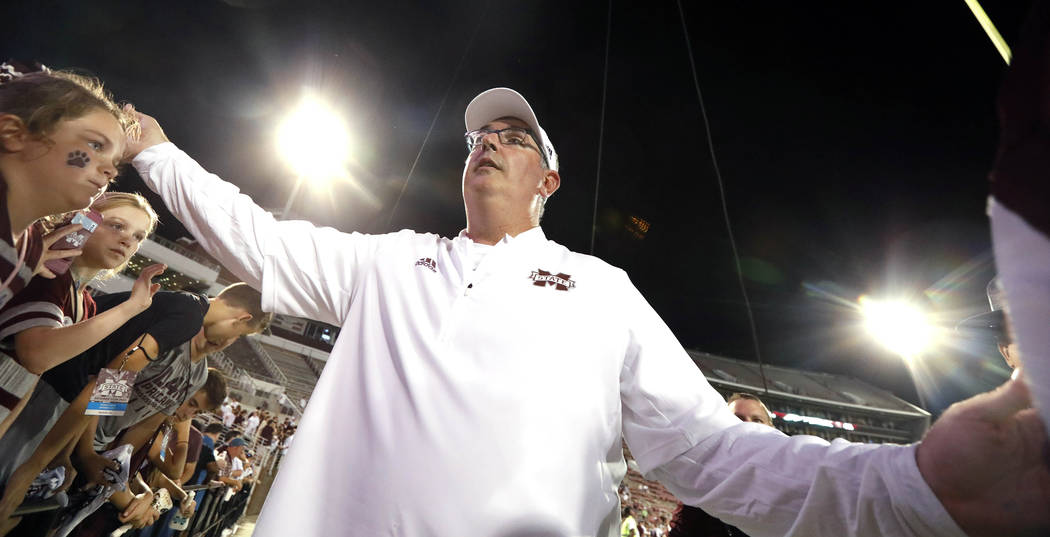 Mississippi State head coach Joe Moorhead celebrates his team's 63-6 win in their NCAA college football game against Stephen. F. Austin on Saturday, Sept. 1, 2018, in Starkville, Miss. (AP Photo/R ...