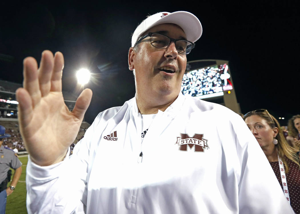 Mississippi State head coach Joe Moorhead celebrates his team's 63-6 win in their NCAA college football game against Stephen. F. Austin, Saturday, Sept. 1, 2018, in Starkville, Miss. (AP Photo/Rog ...
