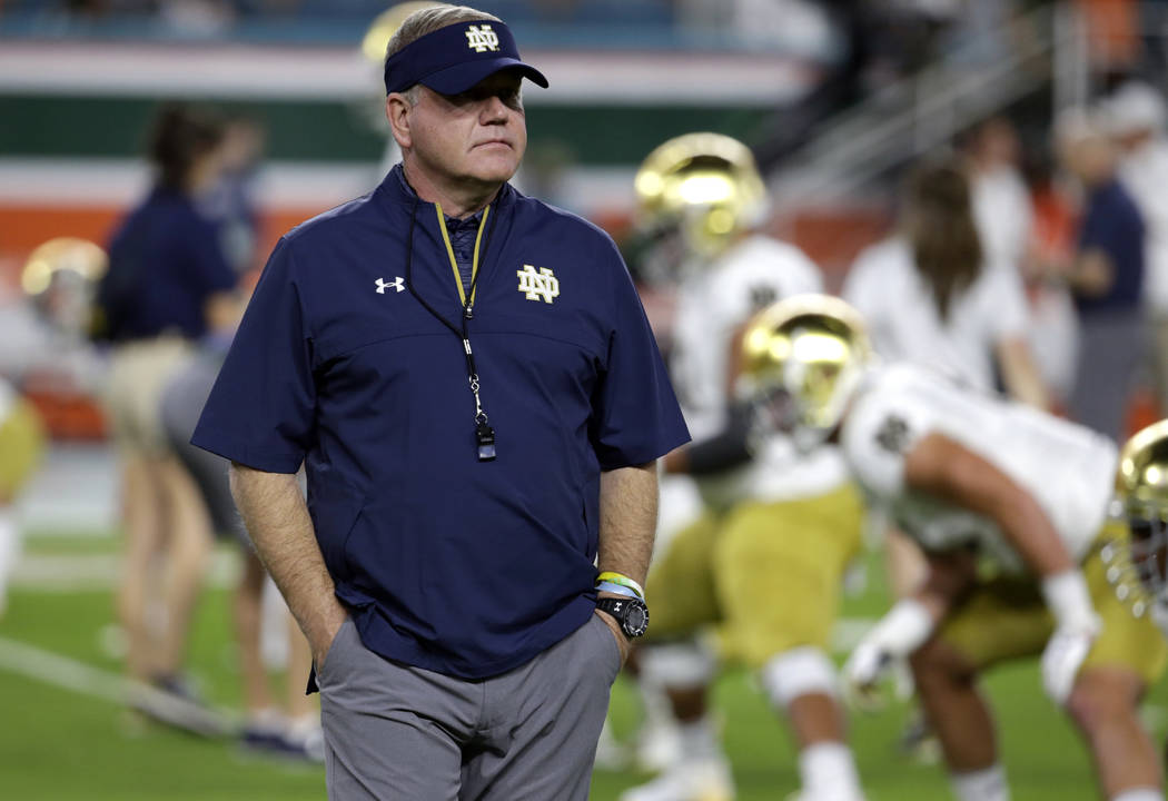 FILE - In this Nov. 11, 2017, file photo, Notre Dame head coach Brian Kelly walks on the field before an NCAA college football game against Miami in Miami Gardens, Fla. Notre Dame faces Stanford o ...