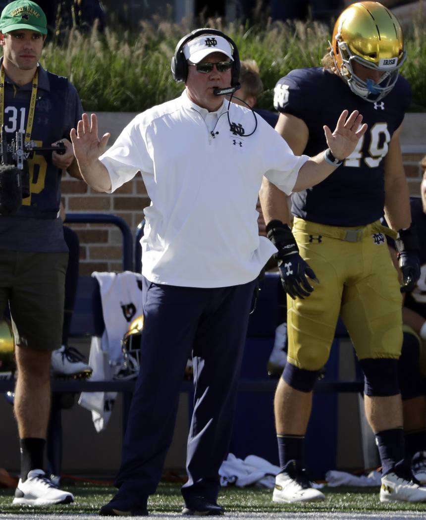 Notre Dame head coach Brian Kelly talks to his team during the second half of an NCAA college football game against Vanderbilt in South Bend, Ind., Saturday, Sept. 15, 2018. Notre Dame won 22-17. ...