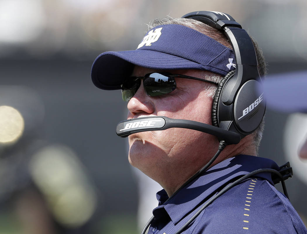 Notre Dame head coach Brian Kelly watches the action in the first half of an NCAA college football game against Wake Forest in Winston-Salem, N.C., Saturday, Sept. 22, 2018. (AP Photo/Chuck Burton)