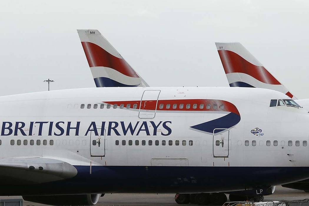 FILE - In this file photo dated Tuesday, Jan. 10, 2017, British Airways planes are parked at Heathrow Airport in London. (Frank Augstein/AP file)