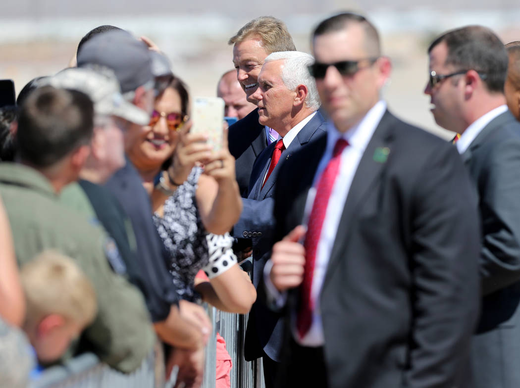 Vice President Mike Pence and U.S. Sen. Dean Heller, meet with Nellis family members after exiting Air Force Two at Nellis Air Force Base in Las Vegas Friday, Sept. 7, 2018. K.M. Cannon Las Vegas ...