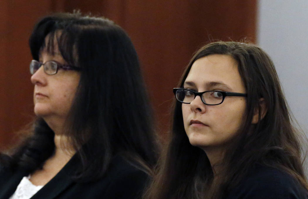 Cassie Smith, right, who faces charges in the death of her 3-year-old son, Daniel Theriot, appears in court with attorney Melinda Simpkins during a hearing at the Regional Justice Center on Friday ...