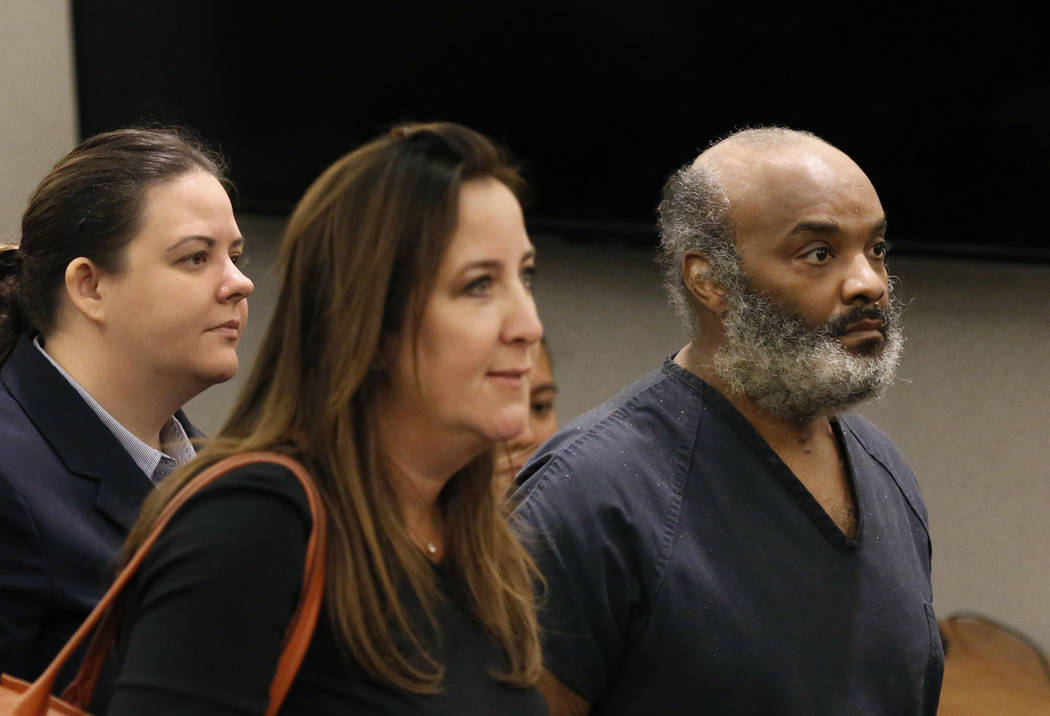 Steve Miller, who pleaded guilty to murder in the fatal stabbing of his girlfriend, appears in court with attorneys Caitlyn McAmis, left, and Kristina Wildeveld at the Regional Justice Center on F ...