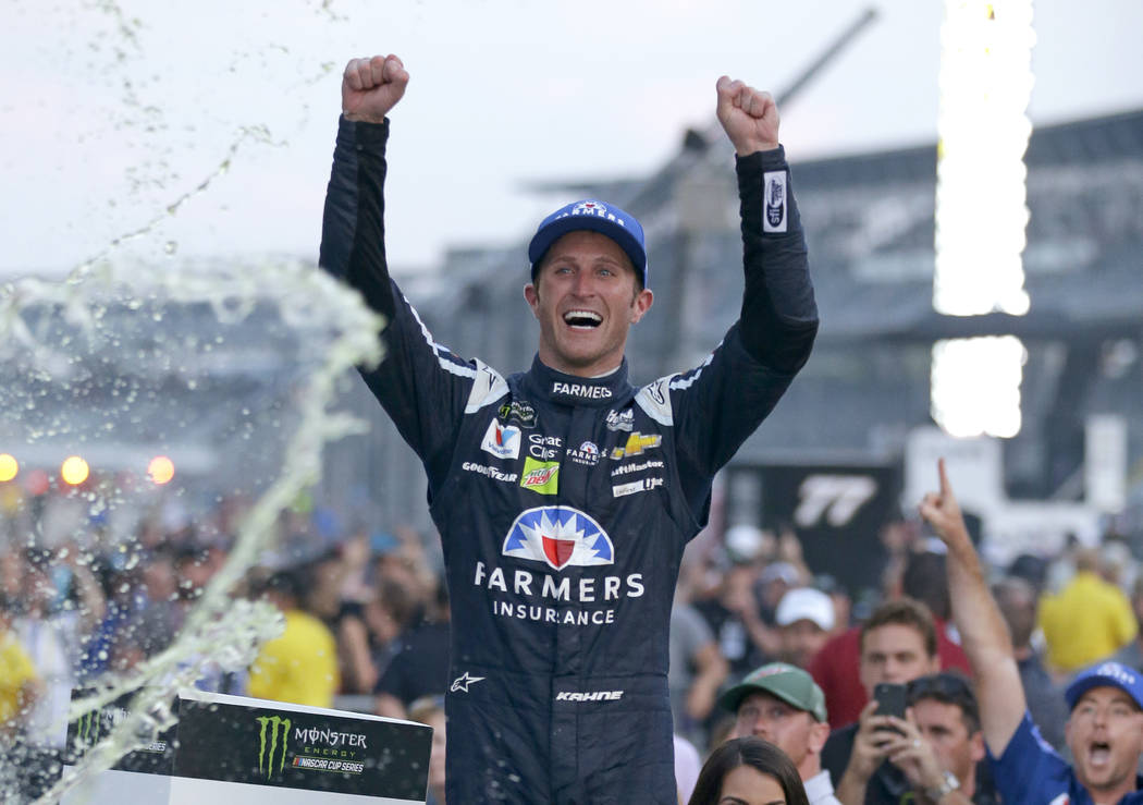 Kasey Kahne (5) celebrates winning the NASCAR Brickyard 400 auto race at Indianapolis Motor Speedway in Indianapolis on July 23, 2017. (AP Photo/Michael Conroy, File)