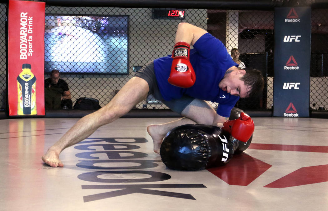 UFC welterweight title contender Darren Till hits a heavy bag during his open workout at the UFC Performance Institute in Las Vegas, Tuesday, Aug. 28, 2018. Till will fight Tyron Wo ...