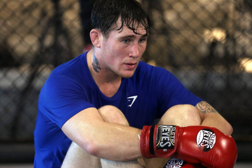 UFC welterweight title contender Darren Till rests during his open workout at the UFC Performance Institute in Las Vegas, Tuesday, Aug. 28, 2018. Till will fight Tyron Woodley for t ...