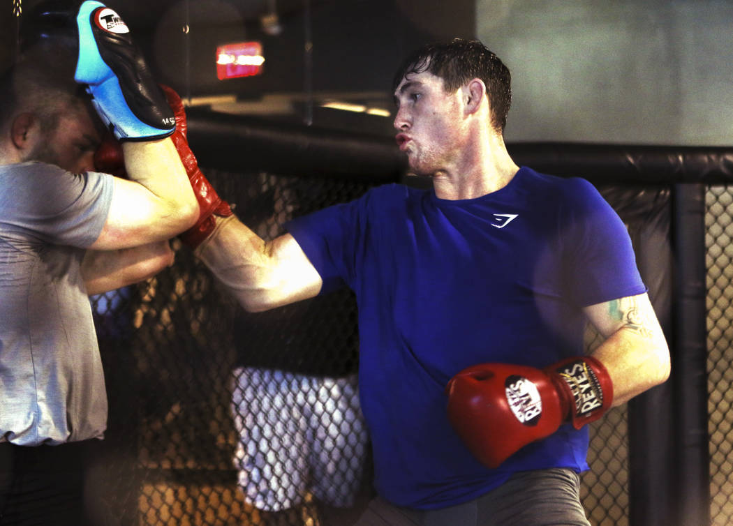 UFC welterweight title contender Darren Till spars during his open workout at the UFC Performance Institute in Las Vegas, Tuesday, Aug. 28, 2018. Till will fight Tyron Woodley for the welterwei ...