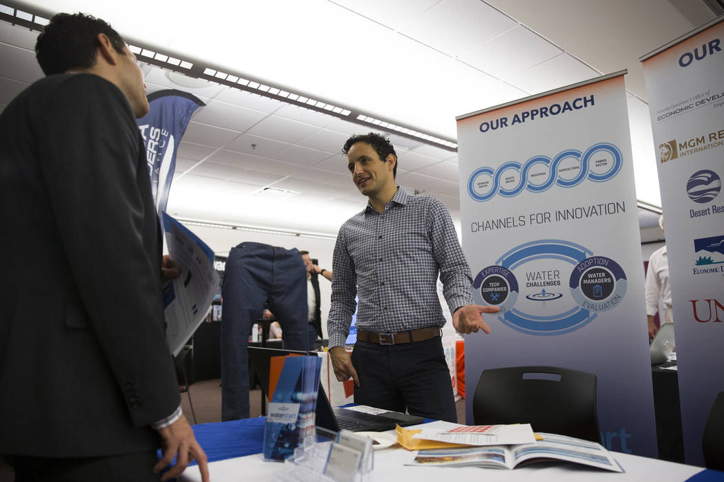 Edgar Antonio Nuñez, left, marketing manager for TSK Architects, speaks with Travis Brewer Lachapelle, technology services manager for WaterStart, during the Nevada Economic Development Confe ...