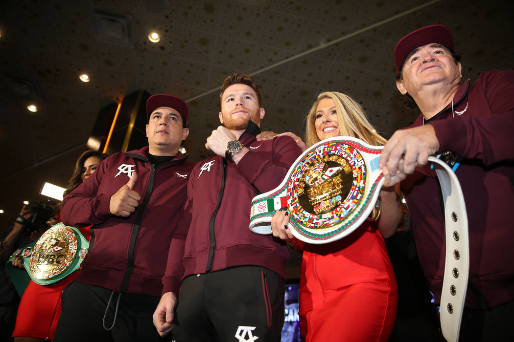 "Saul ""Canelo"" Alvarez, second from left, with his trainers Eddy Reynoso, left, and Jose ""Chepo"" Reynoso, far right, on stage during a ""Grand Arrivals"" event at the MG ..."