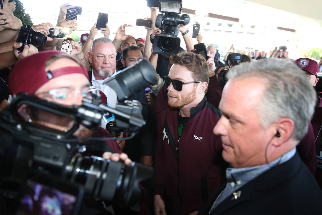 "Saul ""Canelo"" Alvarez, center, makes his way to the stage during a ""Grand Arrivals"" event at the MGM Grand hotel-casino in Las Vegas, Tuesday, Sept. 11, 2018. Erik Verduzco Las ..."