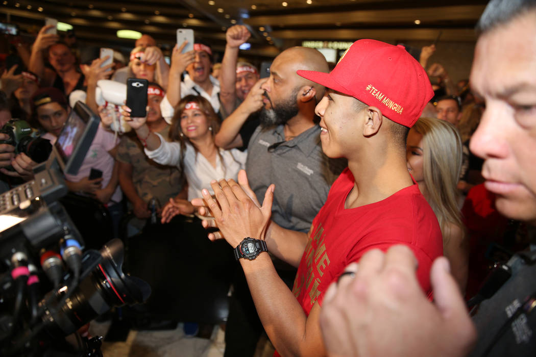 "Jaime Munguia, center, makes his way to the stage during the ""Grand Arrivals"" at the MGM Grand hotel-casino in Las Vegas, Tuesday, Sept. 11, 2018. Erik Verduzco Las Vegas Review-Journal ..."