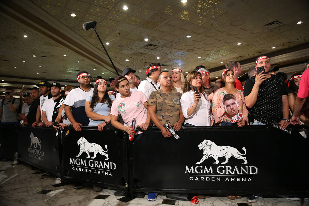"People attend a boxing ""Grand Arrivals"" event for Gennady Golovkin and Saul ""Canelo"" Alvarez at the MGM Grand hotel-casino in Las Vegas, Tuesday, Sept. 11, 2018. Erik Verduzco ..."