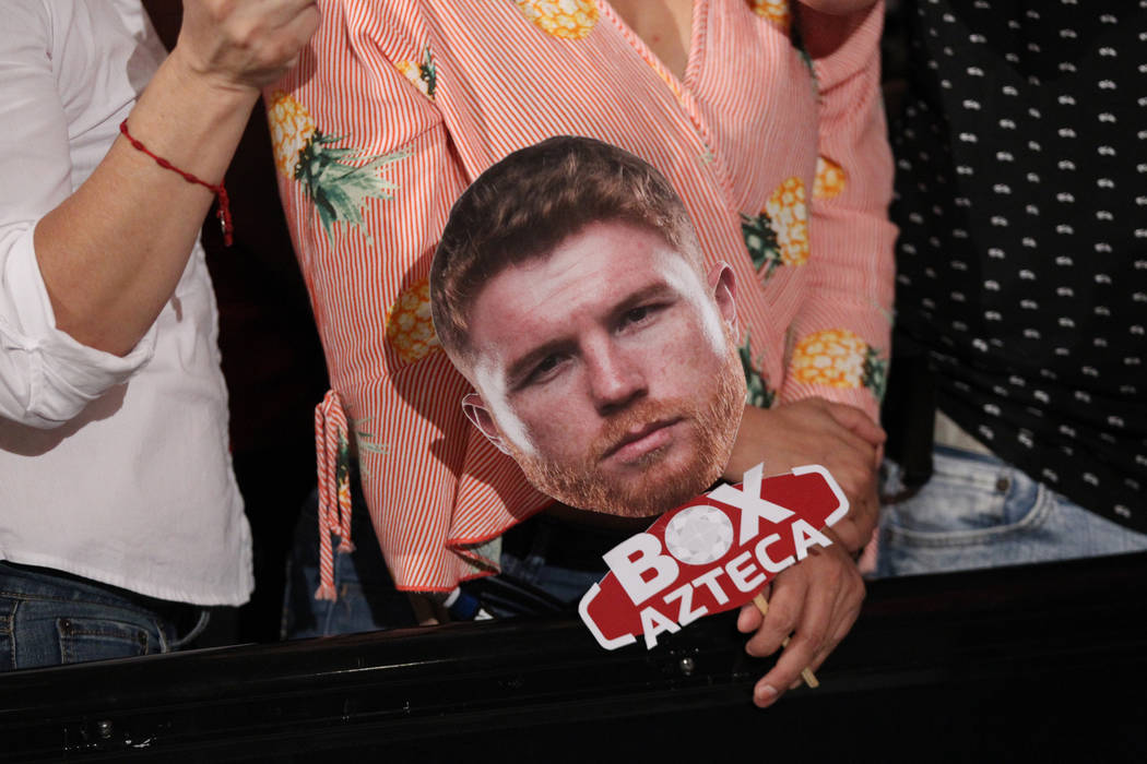 "A person holds a face cutout of Saul ""Canelo"" Alvarez during a boxing ""Grand Arrivals"" event at the MGM Grand hotel-casino in Las Vegas, Tuesday, Sept. 11, 2018. Erik Verduzco ..."