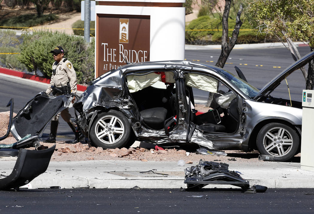 Las Vegas police investigate a fatal three-vehicle crash at Eastern and Harmon avenues on Friday, Aug. 31, 2018, in Las Vegas. (Bizuayehu Tesfaye/Las Vegas Review-Journal) @bizutesfaye