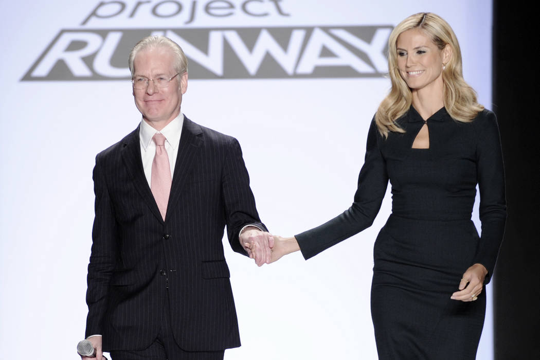 Project Runway's Tim Gunn walks with Heidi Klum on the runway during Fashion Week in New York on Sept. 12, 2008. (AP Photo/Richard Drew, file)