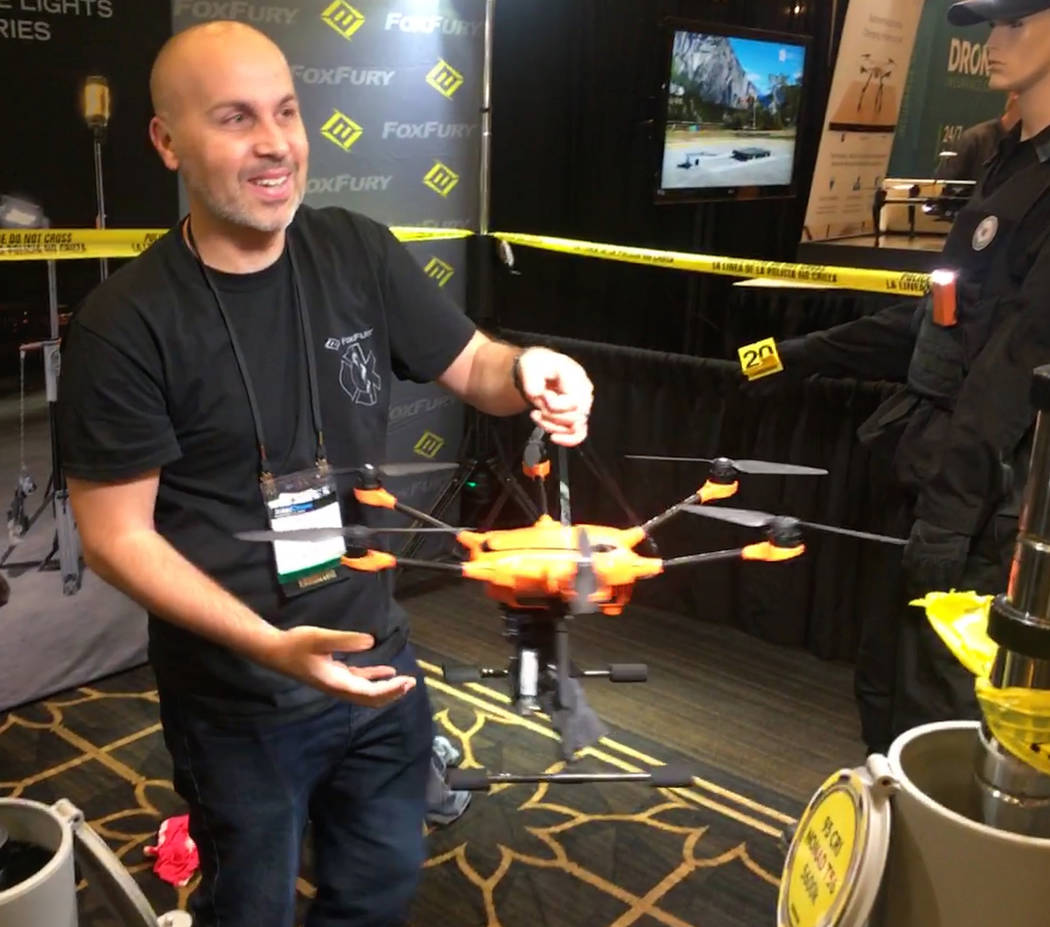 Richard Staggs, CEO of Rotor Eagle Inc., examines a drone during InterDrone at the Rio on Sept. 7, 2018. (Bailey Schulz/Las Vegas Review-Journal)