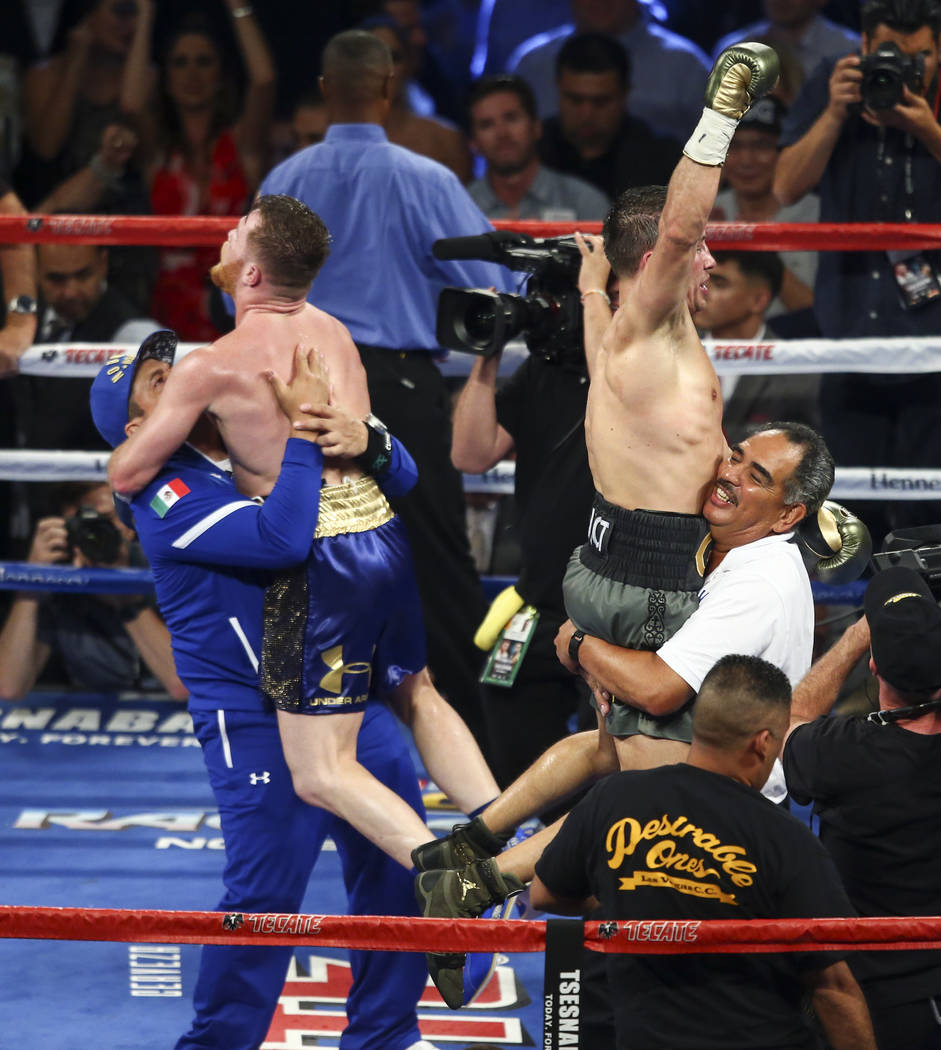 """Saul """"Canelo"""" Alvarez, left, and Gennady ҇GGӠGolovkin at the end of their middleweight championship boxing match at T-Mobile Arena in Las Vegas on Saturday, Sept. 16, 2017. T ..."""