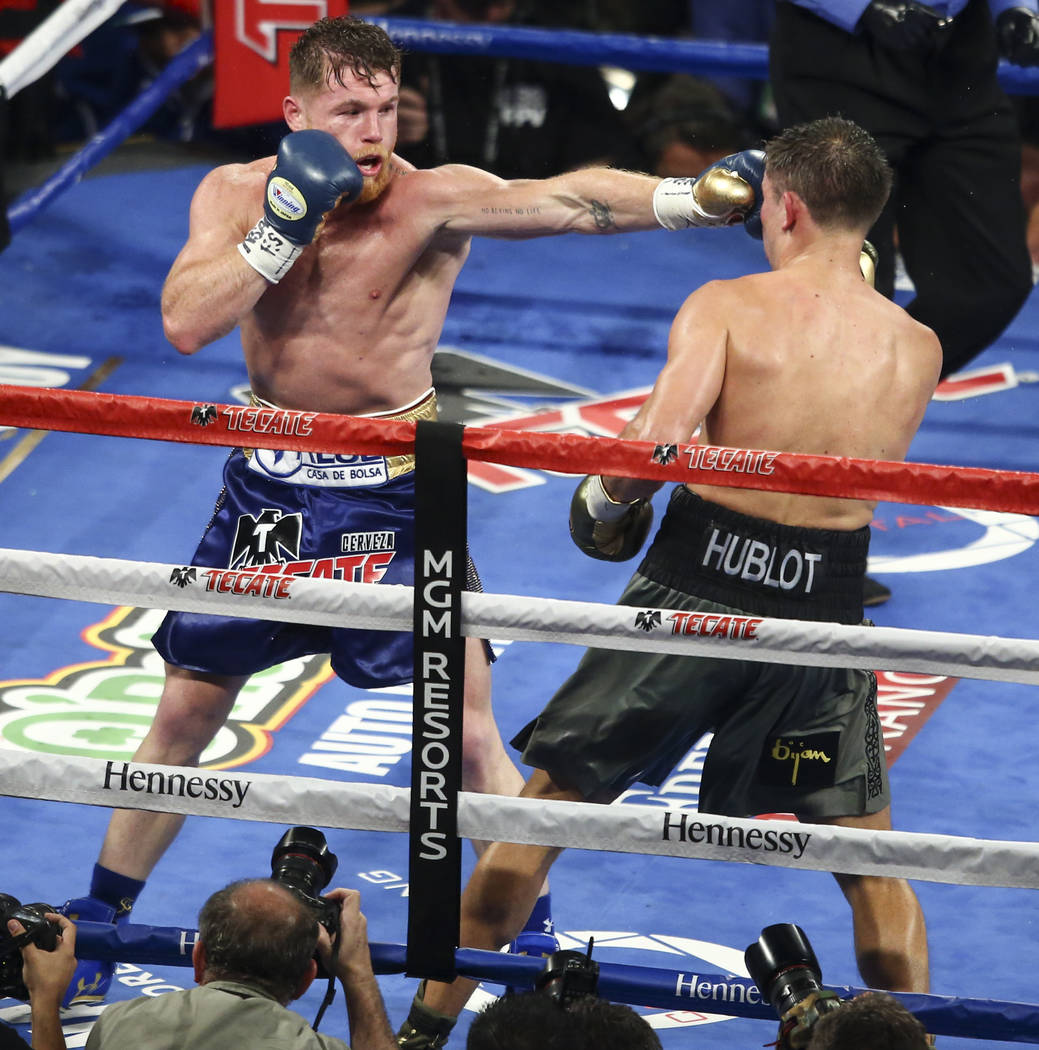 """Saul """"Canelo"""" Alvarez, left, hits Gennady ҇GGӠGolovkin during their middleweight championship boxing match at T-Mobile Arena in Las Vegas on Saturday, Sept. 16, 2017. The fig ..."""