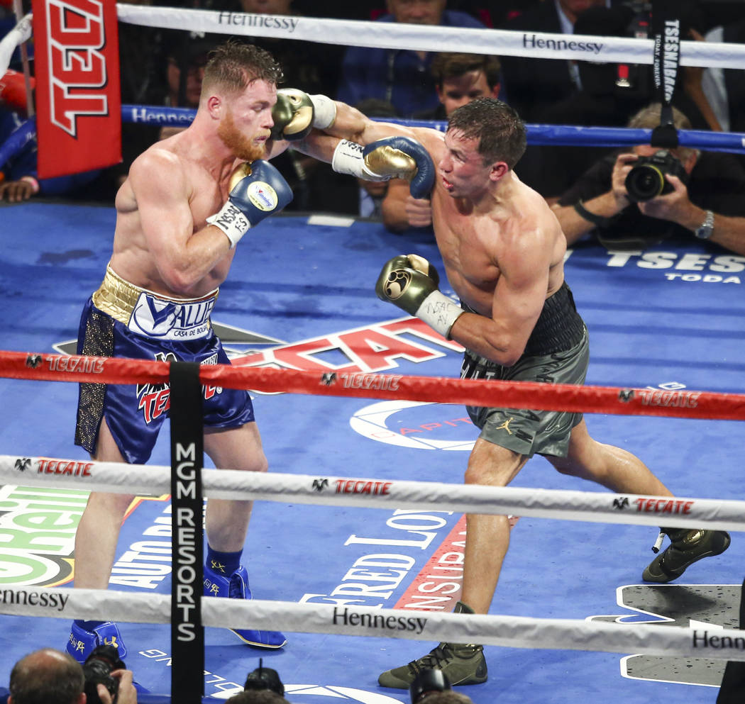 """Saul """"Canelo"""" Alvarez, left, fights Gennady ҇GGӠGolovkin during their middleweight championship boxing match at T-Mobile Arena in Las Vegas on Saturday, Sept. 16, 2017. The f ..."""
