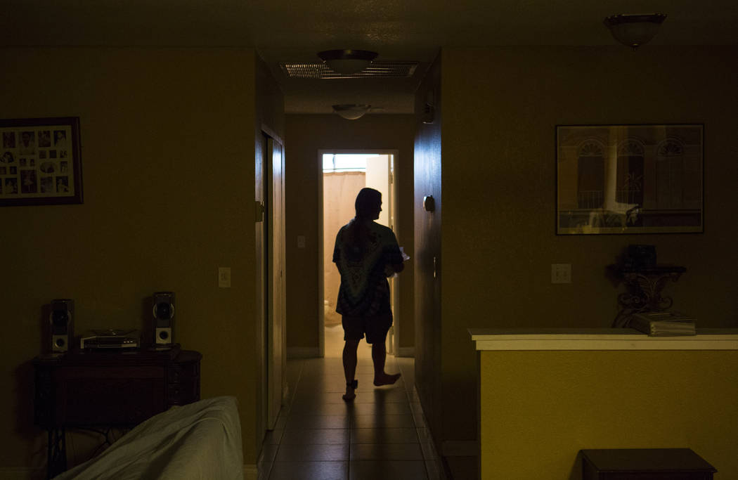 Timothy Tyler gets ready at his sister's home in Las Vegas before visiting a halfway house to remove his ankle monitor at the completion of his sentence on Aug. 30, 2018. Tyler originally was sent ...