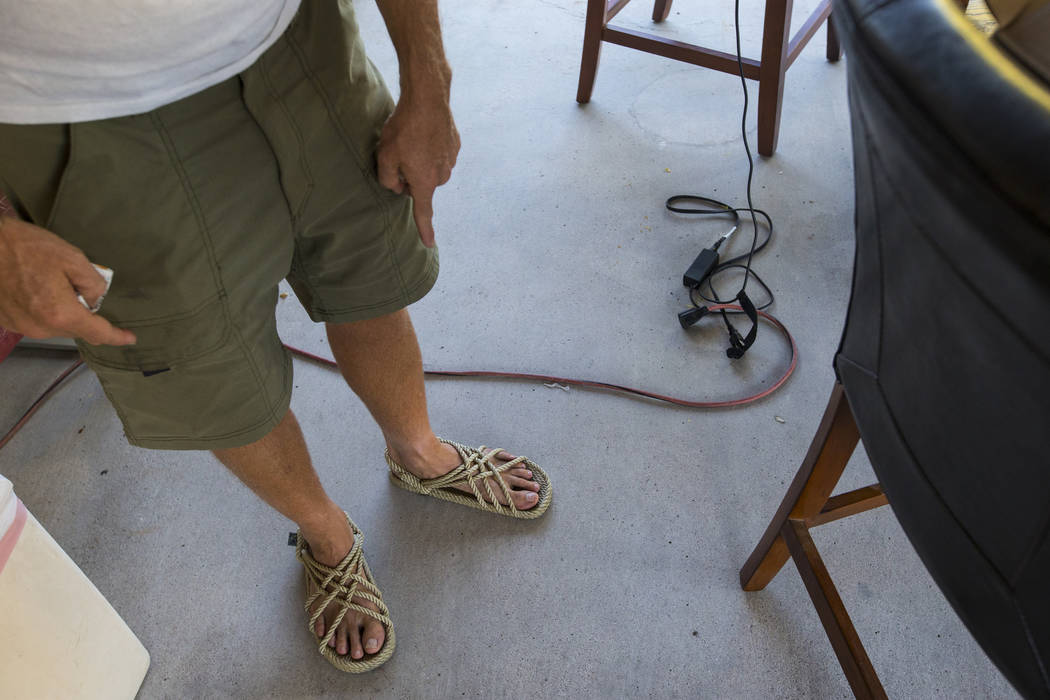 Timothy Tyler points to his sandles after visiting a halfway house to remove his ankle monitor at the completion of his sentence on Aug. 30, 2018. Tyler originally was sentenced in 1994 to life wi ...