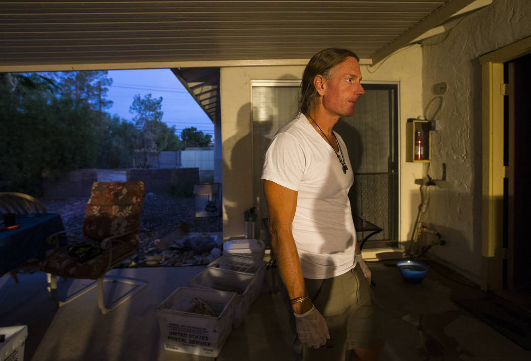 Timothy Tyler works on making tie-dye shirts while relaxing with friends and family after visiting a halfway house to remove his ankle monitor at the completion of his sentence on Aug. 30, 2018. T ...