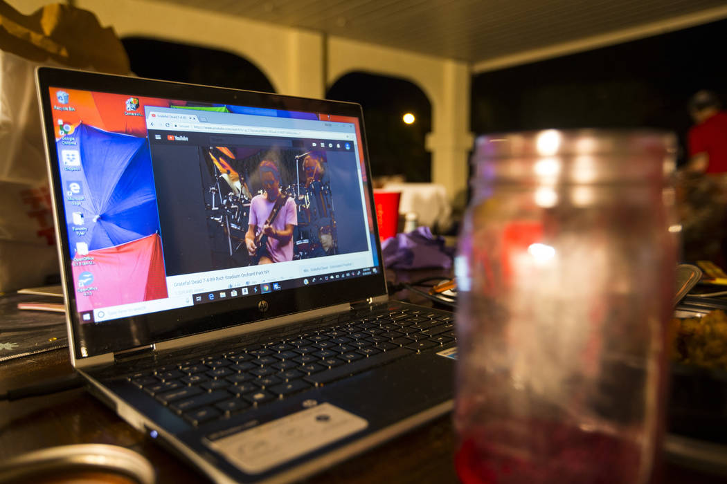 A Grateful Dead performance plays on a laptop as Timothy Tyler, not pictured, relaxes with friends and family on Aug. 30, 2018. Chase Stevens Las Vegas Review-Journal @csstevensphoto