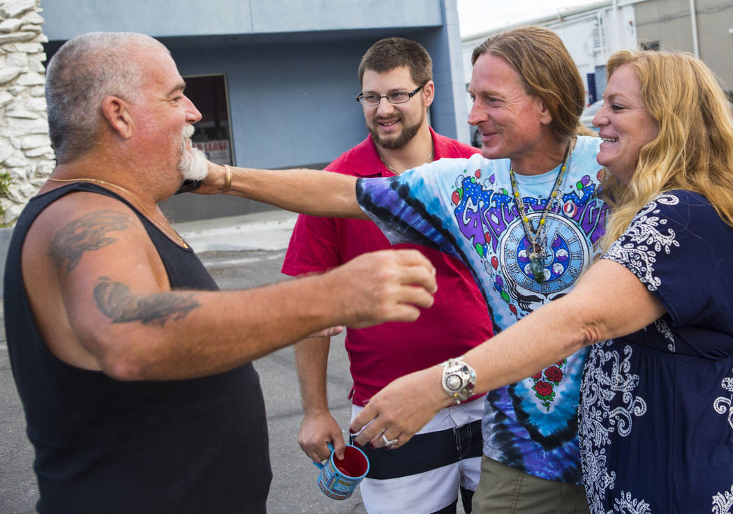 Dave Phelps, left, reaches out to hug his cousin Timothy Tyler, third from left, alongside Tyler's son Jimmy Newhart, second from left, and friend Hilary, after Tyler visited a halfway house to re ...