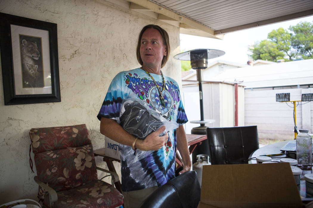 Timothy Tyler holds an ankle monitoring device at his sister's home in Las Vegas before visiting a halfway house to remove his ankle monitor on Aug. 30, 2018. Tyler originally was sentenced in 199 ...