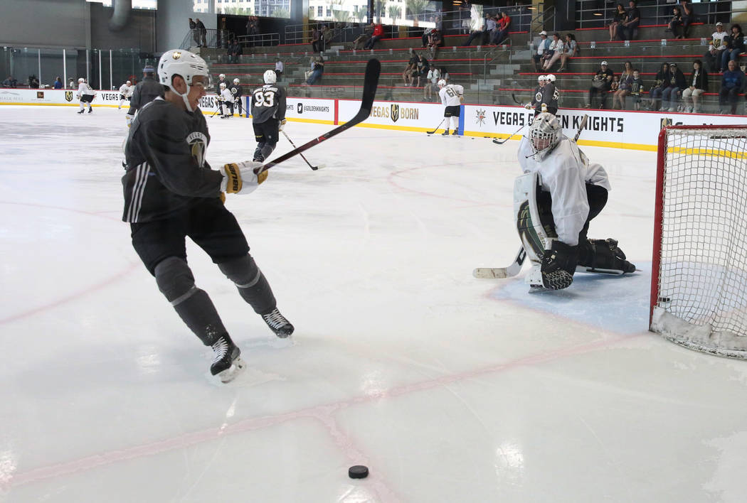 Golden Knights goalie Jordan Kooy deflects the shot from forward Nick Suzuki during Knights rookie camp practice at City National Arena in Las Vegas on Friday, Sept. 7, 2018, in Las Vegas. (Bizuay ...