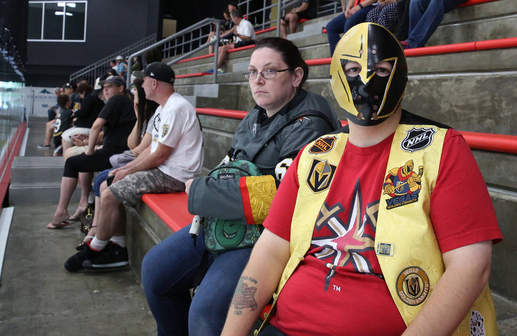 Donald Nault, right, and his fiancé Justine Boldwin, both of Mesquite, Nev., watch Golden Knights rookie camp practice at City National Arena in Las Vegas on Friday, Sept. 7, 2018, in Las Veg ...