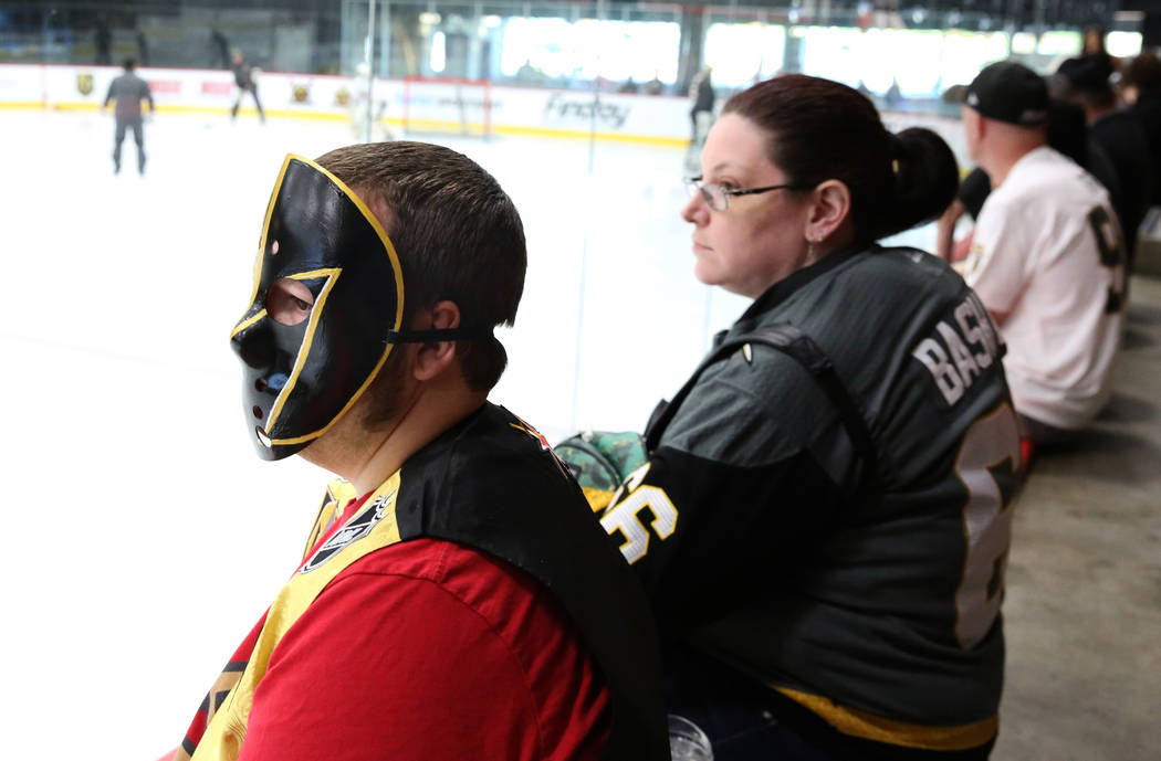 Donald Nault, left, and his fiancé Justine Boldwin, both of Mesquite, Nev., watch Golden Knights rookie camp practice at City National Arena in Las Vegas on Friday, Sept. 7, 2018, in Las Vega ...