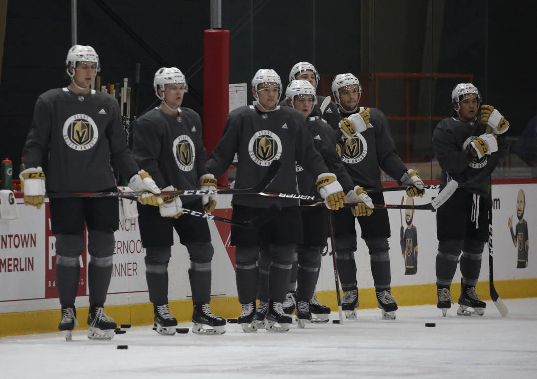 Golden Knights players listen to their coaches during Knights rookie camp practice at City National Arena in Las Vegas on Friday, Sept. 7, 2018, in Las Vegas. (Bizuayehu Tesfaye/Las Vegas Review-J ...