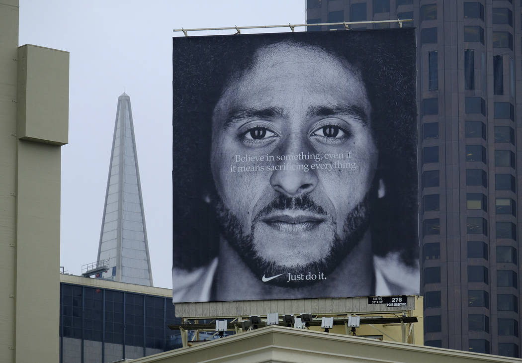 A large billboard stands on top of a Nike store showing former San Francisco 49ers quarterback Colin Kaepernick at Union Square, Wednesday, Sept. 5, 2018, in San Francisco. (AP Photo/Eric Risberg)