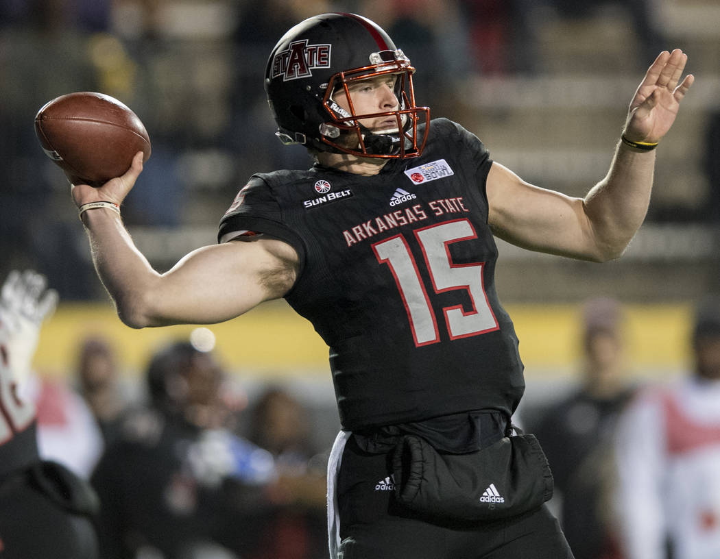 FILE - In this Dec. 6, 2017, file photo, Arkansas State quarterback Justice Hansen (15) throws against Middle Tennessee during the first half of the Camellia Bowl NCAA college football game, in M ...