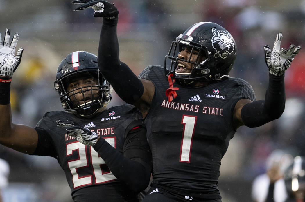 Arkansas State cornerback Jerry Jacobs (1) and linebacker Trent Ellis-Brewer (26) celebrate a play against UNLV during an NCAA college football game Saturday, Sept. 22, 2018, Jonesboro, Ark. (Jaco ...