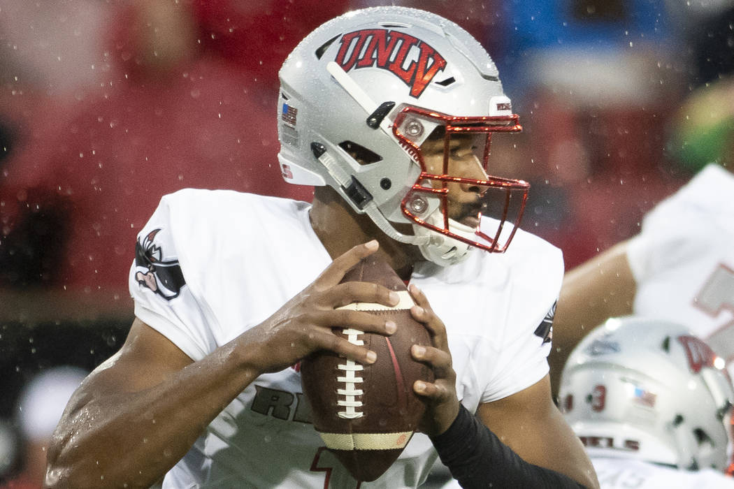 UNLV quarterback Armani Rogers (1) looks for a receiver during an NCAA college football game against Arkansas State on Saturday, Sept. 22, 2018, Jonesboro, Ark. (Jacob Wiegand/The Jonesboro Sun vi ...