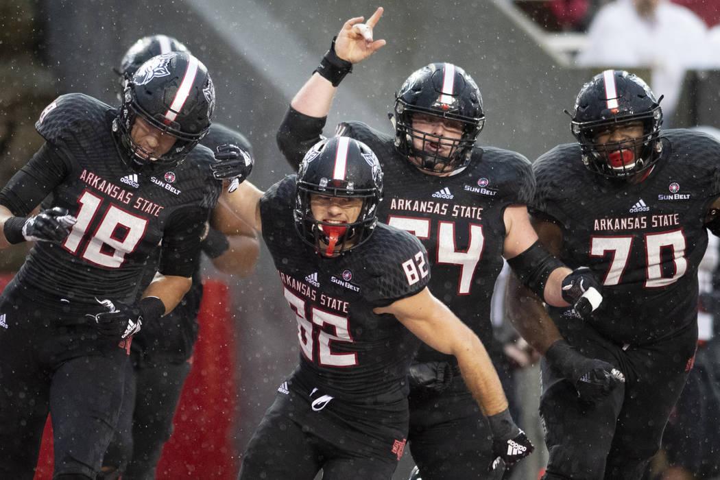 Arkansas State players celebrate a touchdown in the first quarter against UNLV during an NCAA college football game Saturday, Sept. 22, 2018, Jonesboro, Ark. (Jacob Wiegand/The Jonesboro Sun via AP)